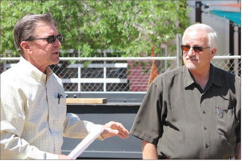 Developer Bob Pofahl and architect Steve Newby lead city officials on a tour of the Las Cruces Civic Plaza construction site April 25.